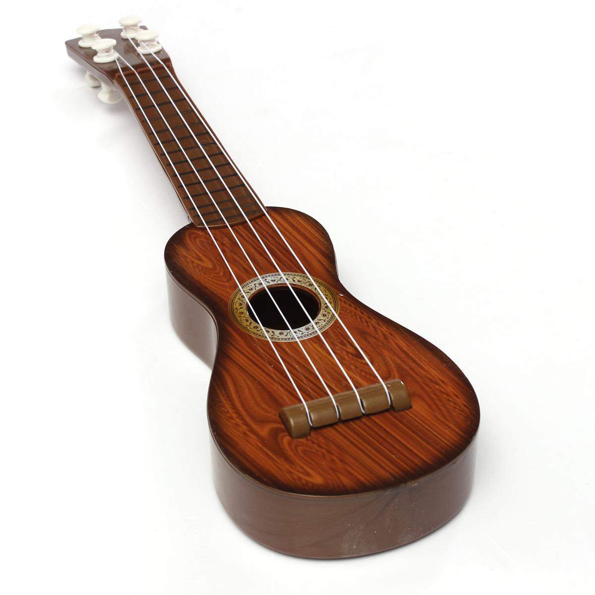 Mini Guitare Instrument 4 Cordes Musique Jouet Educatif Cadeaux Enfant